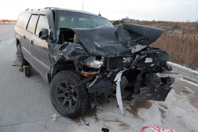 CW #1's GMC Yukon Denali after it rear-ended the SO's vehicle.
