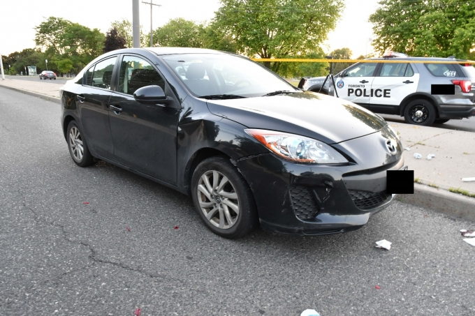 Figure 3 - The front, passenger-side damage to the Mazda.